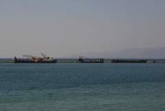 barges dredgers and a tug laid up@ patra's south breakwater