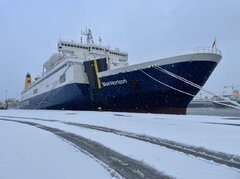 Blue Horizon at snowy Piraeus