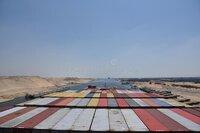 large-cargo-container-ship-transiting-suez-canal-cargo-container-ship-transiting-suez-canal-view-158666683.jpg